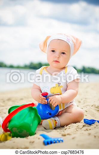 Little cute girl on the beach - csp7683476