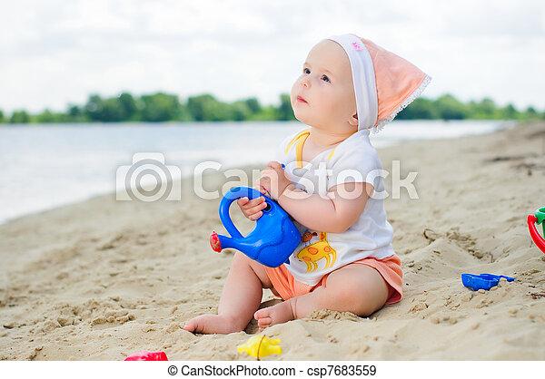 Little cute girl on the beach - csp7683559