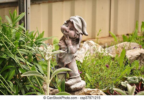 Little garden gnome in the rockery - csp37971215
