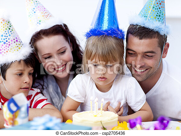 Little girl admiring a cake on her birthday\'s day - csp2705436