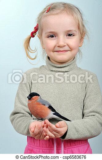 little girl and bullfinch - csp6583676
