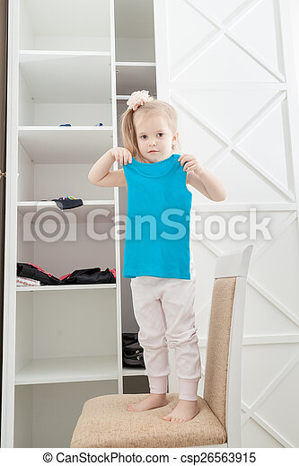 Little girl and clothes - csp26563915