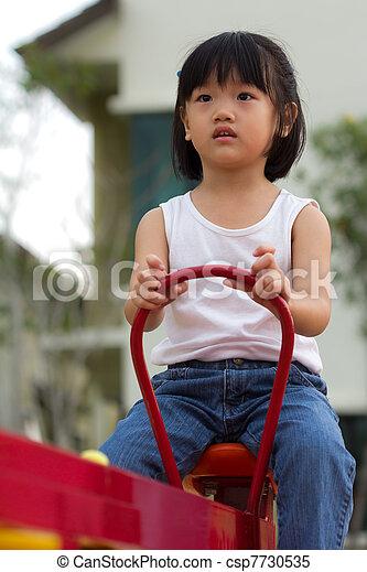 Little girl at outdoor - csp7730535