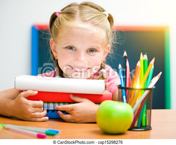 little girl at workplace with the books - csp15298276