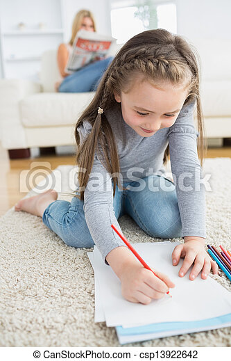 Little girl drawing sitting on floor - csp13922642