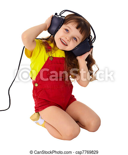 Little Girl Enjoys Music In Big Headphones A Little Girl Enjoys