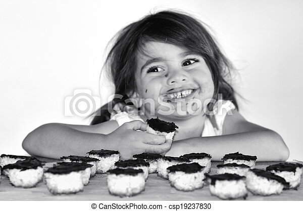 Little girl getting caught eating chocolate cookies - csp19237830