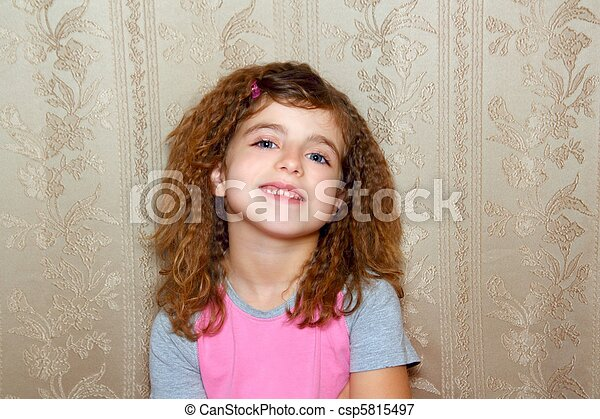 little girl happy funny expression on vintage wallpaper - csp5815497