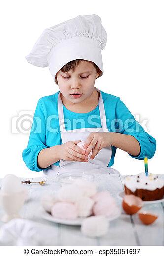 little girl in a cap Chef - csp35051697