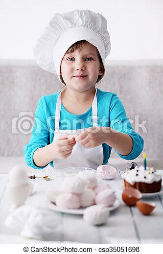 little girl in a cap Chef - csp35051698
