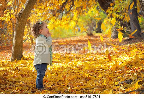 Little girl in autumn park - csp51617801