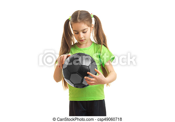 c1df3729a little girl in green sports uniform with soccer ball in hands - csp49060718