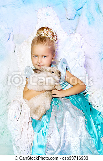3e39703a65e97 Little Girl In Princess Dress On A Background Of A Winter Fairy Tale. Baby  Snow Queen. Smiling Child