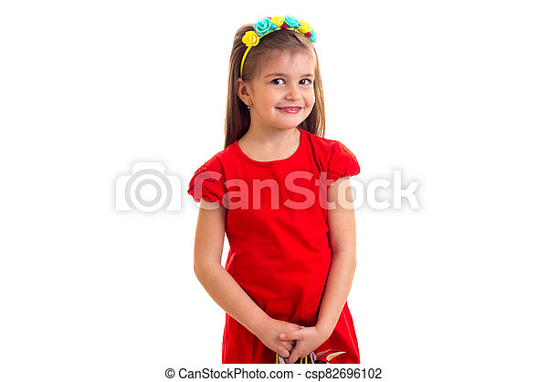 Little girl in red dress at white background. - csp82696102