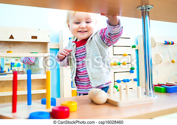 little girl in the classroom early development - csp16028460