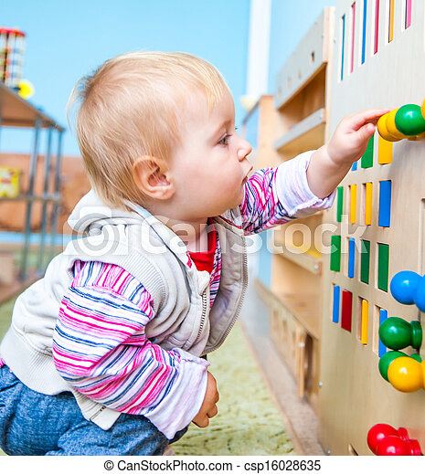little girl in the classroom early development - csp16028635