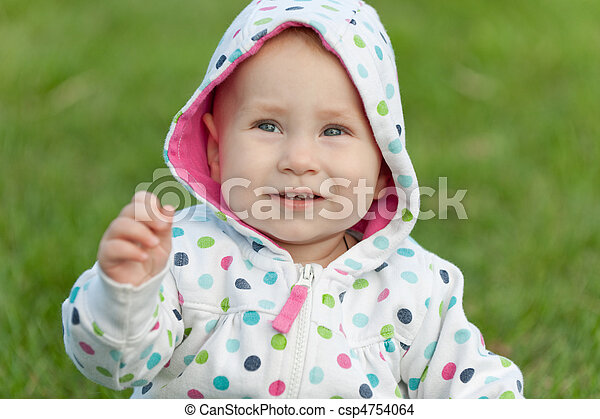 Little girl in the polka dot jacket - csp4754064