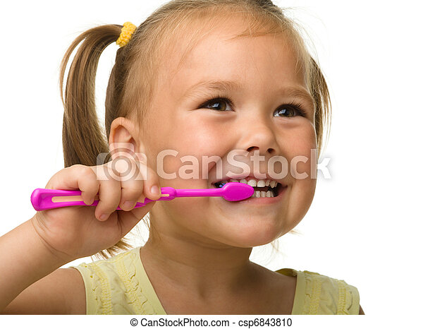 Little girl is cleaning teeth using toothbrush - csp6843810