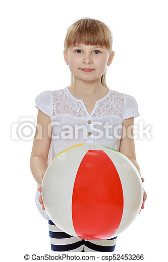 Little girl is playing with a ball - csp52453266