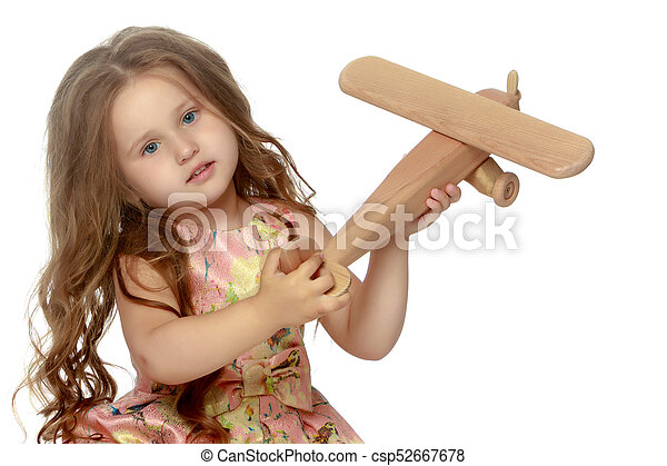 Little girl is playing with a plane - csp52667678