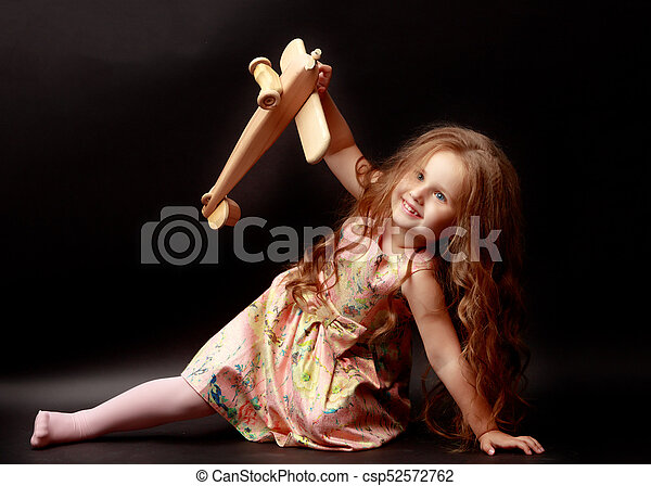 Little girl is playing with a plane - csp52572762