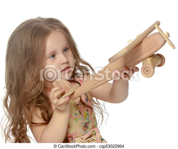 Little girl is playing with a plane - csp53022964