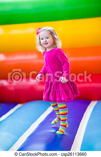 Little girl jumping and bouncing  - csp26113660
