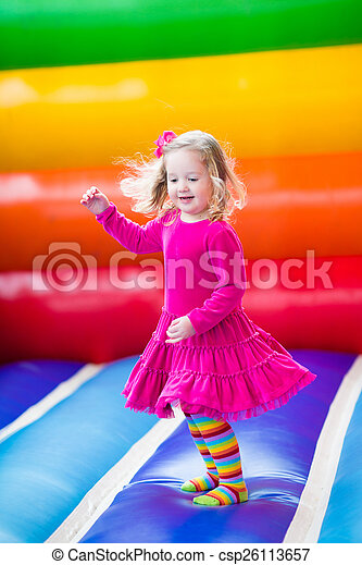 Little girl jumping and bouncing  - csp26113657