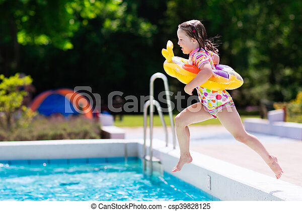 Little Girl Jumping Into Swimming Pool Happy Little Girl With Inflatable Toy Ring Jumping Into
