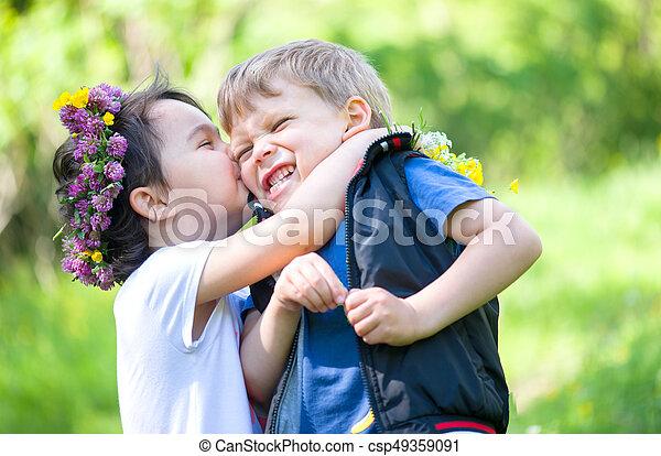 Little girl kissing a little boy little girl kissing a little boy csp49359091 altavistaventures Images