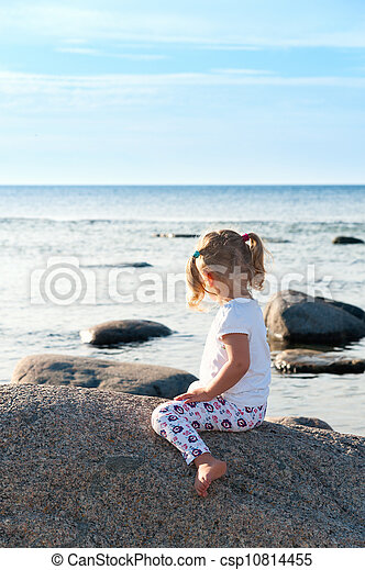 Little girl looking out to sea - csp10814455