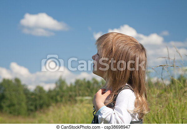 Little Girl Looks At The Sky With Clouds