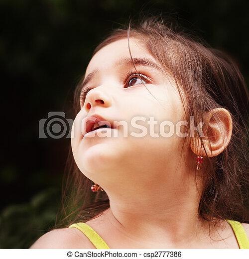 Little girl looks up - csp2777386