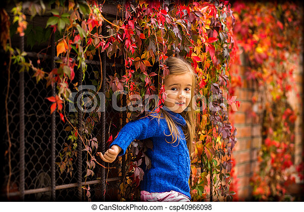 f834a62599ca Little girl on a beautiful background of autumn wild grapes. Little ...