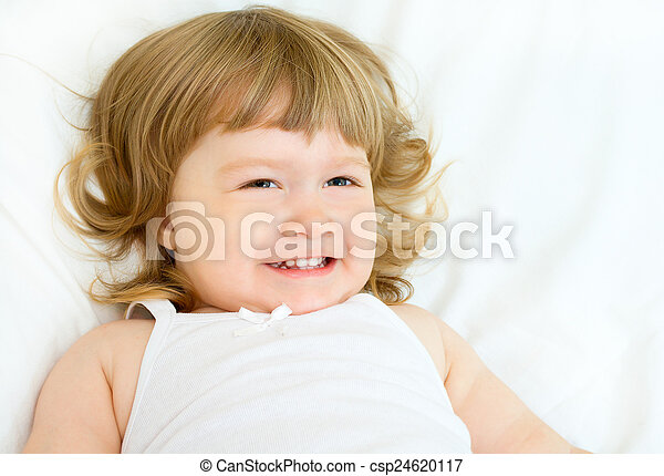 Little girl on a bed - csp24620117