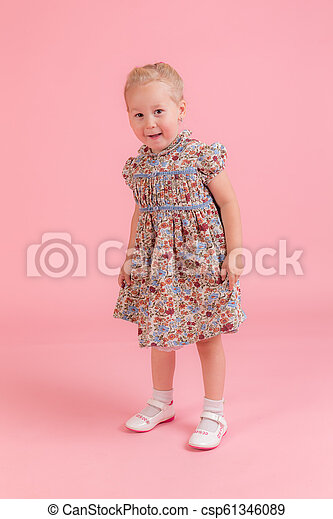 little girl on a pink background - csp61346089
