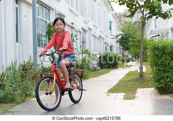 Asian Girl On Bike