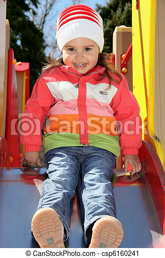 Little Girl on Playground Ready to Slide - csp6160241