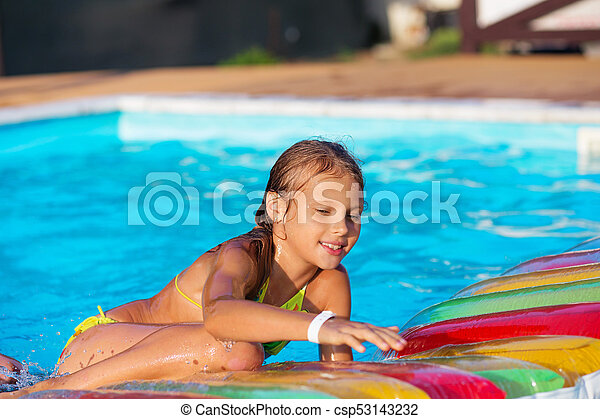 7be241c4003a Little Girl Playing And Having Fun In Swimming Pool With Air Mattress. Kid  Playing In Water.