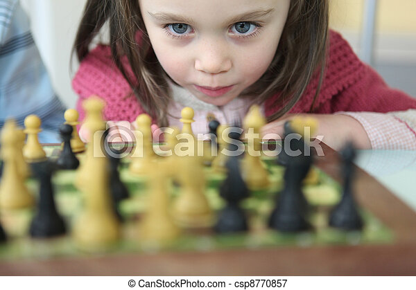 little girl playing chess - csp8770857