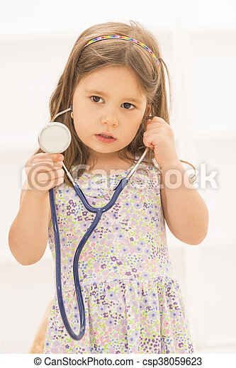 610607af2c322 Little girl playing doctor. Portrait of cute little girl holding in ...
