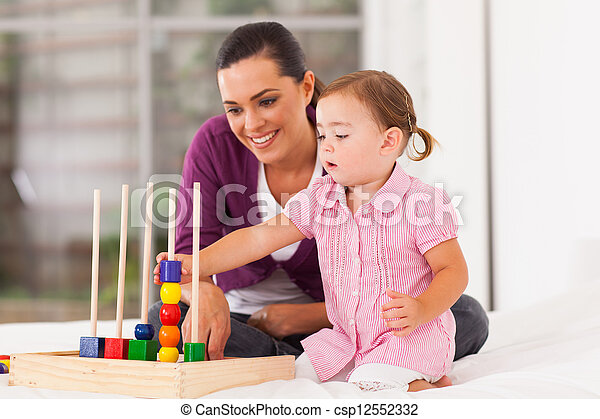 little girl playing educational toy  - csp12552332