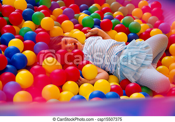 Little girl playing in inflatable bouncing castle - csp15507375