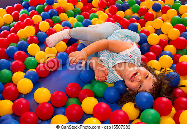 Little girl playing in inflatable bouncing castle - csp15507383