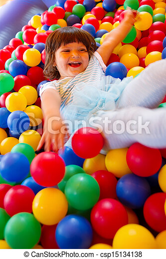 Little girl playing in inflatable bouncing castle - csp15134138