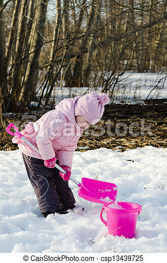 Little girl playing in the winter with snow  - csp13439725