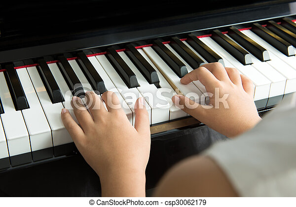 Little girl playing piano - csp30062179
