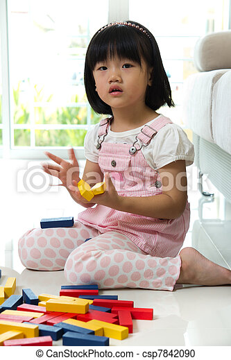 Little girl playing with blocks - csp7842090