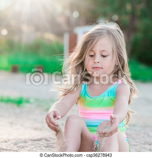 Little girl playing with sand - csp36278943