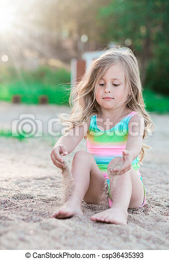 Little girl playing with sand - csp36435393